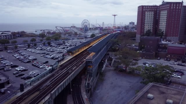 aerial shot of a subway train passing through coney island, brooklyn. - coney island brooklyn stock videos and b-roll footage