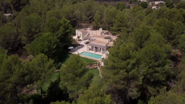 aerial shot of a sunny spanish villa. - outdoor chair stock videos & royalty-free footage