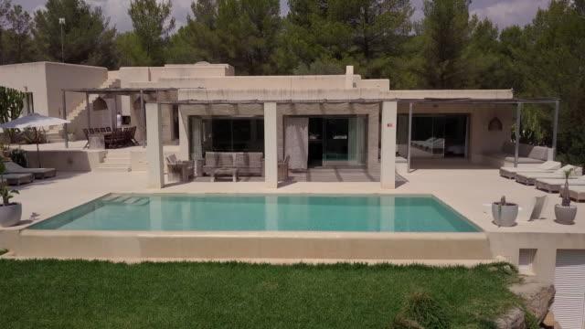 aerial shot of a sunny spanish villa. - holiday villa stock videos & royalty-free footage