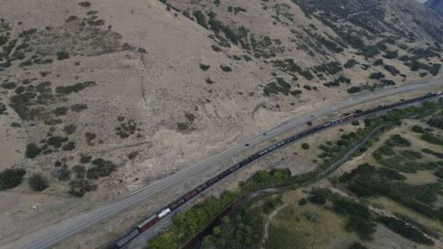 Aerial Shot of A Train Passing Through A Valley