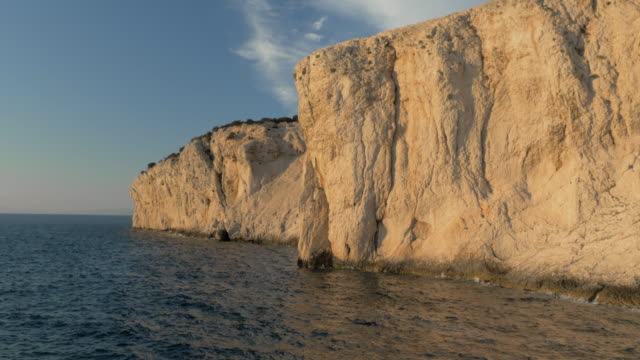 aerial shot of a white cliff along a sea - rock face stock videos and b-roll footage