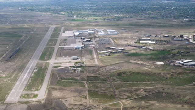 aerial shot of an air strip in western colorado - airfield stock videos & royalty-free footage