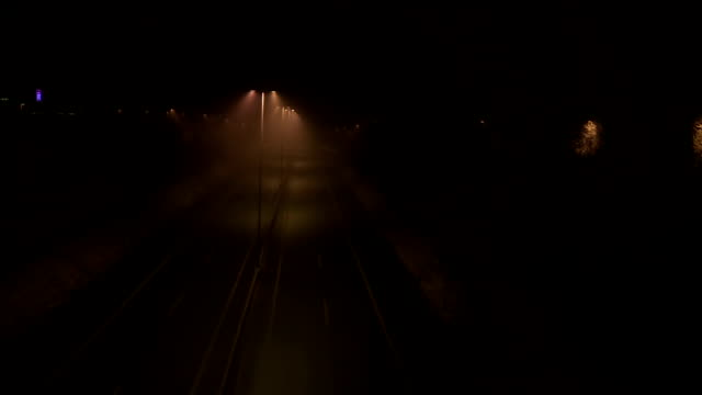 aerial shot of an empty freeway at night - fog stock videos & royalty-free footage