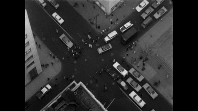 aerial shot of an intersection in new york city with traffic - danger stock videos & royalty-free footage