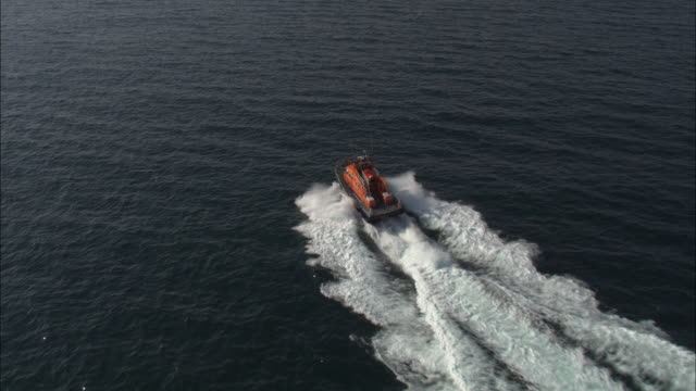 aerial shot of an rnli lifeboat sailing along the coast of county donegal. - coast guard stock videos and b-roll footage