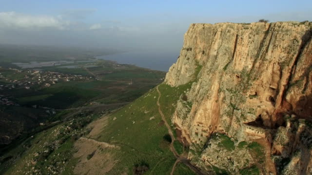 Aerial shot of Arbel cliff with the Sea of Galilee in the background, Lower Galilee, Israel