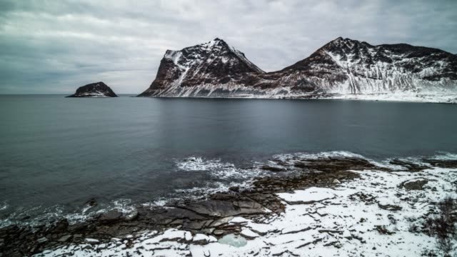 aerial shot of arctic winter coastline in norway - bay of water stock videos & royalty-free footage