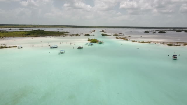 aerial shot of bacalar lagoon in mexico - mayan riviera stock videos and b-roll footage