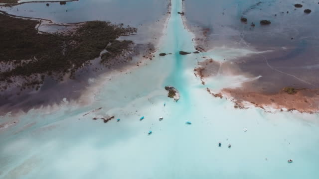 aerial shot of bacalar lagoon in mexico - lagoon stock videos & royalty-free footage