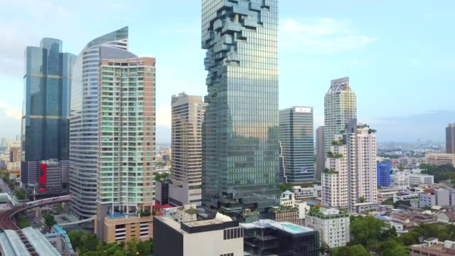 aerial shot of bangkok city, silom/sathon central business district - bangkok stock videos & royalty-free footage