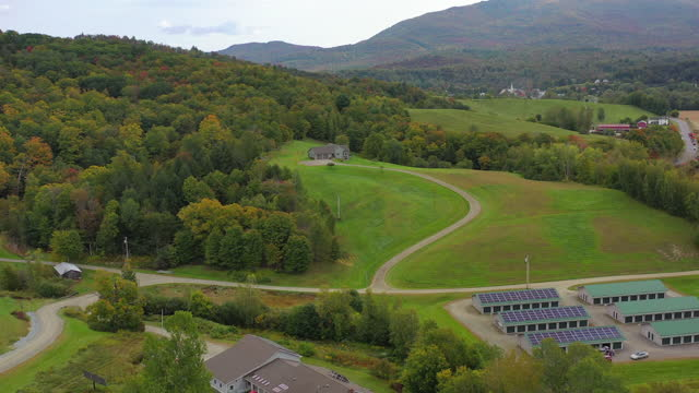 aerial shot of beautiful landscape during autumn, drone panning over trees - lake groton, vermont - vermont stock videos & royalty-free footage