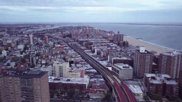 aerial shot of brooklyn's coney island on a gloomy day. - coney island brooklyn stock videos and b-roll footage