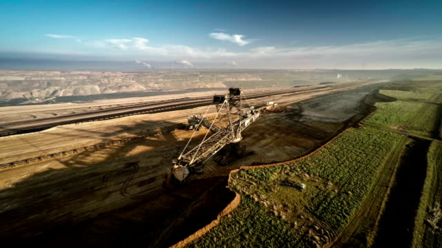 aerial shot of brown coal surface mine - surface mine stock videos and b-roll footage