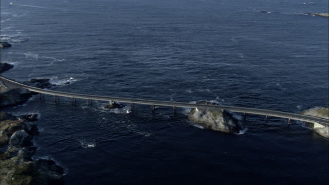 Aerial shot of cars travelling on the Atlantic Ocean Road in western Norway.