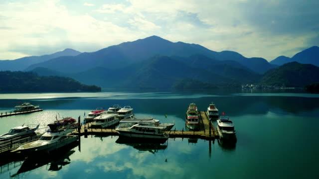aerial shot of chaowu pier, sun moon lake, taiwan - sun moon lake stock videos and b-roll footage