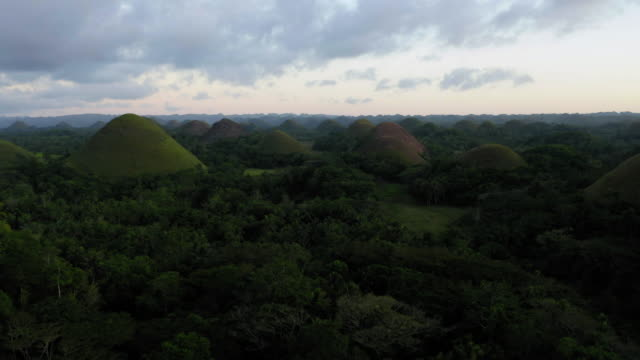 aerial shot of chocolate hills, bohol, philippines - philippines stock videos & royalty-free footage