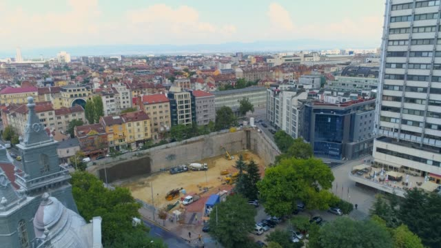 aerial shot of city construction site in business district sofia, bulgaria - bulgaria video stock e b–roll