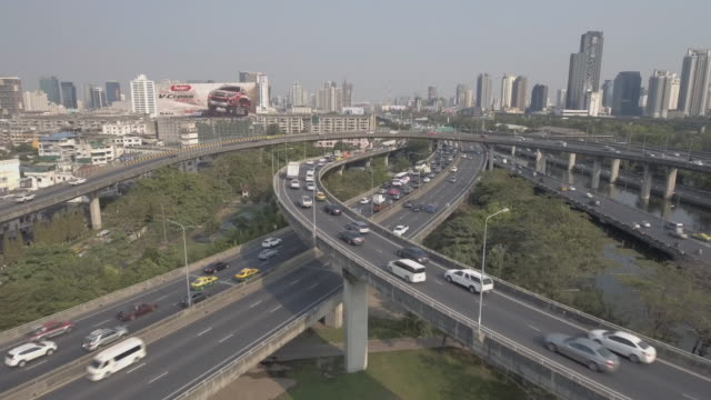 aerial shot of city traffic on elevated road