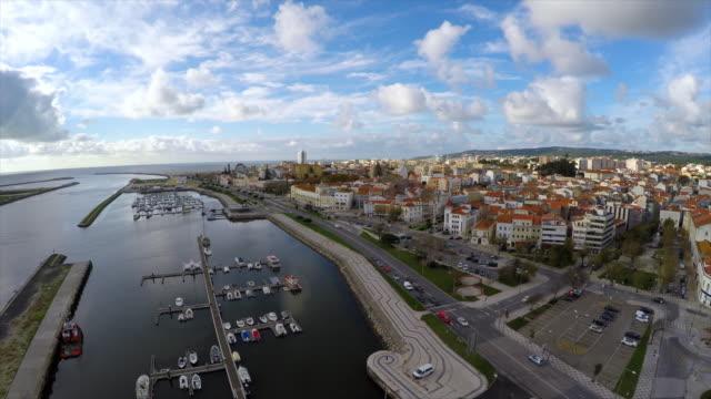 stockvideo's en b-roll-footage met aerial shot of cityscape against cloudy sky, drone is flying backwards - figueira da foz, portugal - achterstevoren