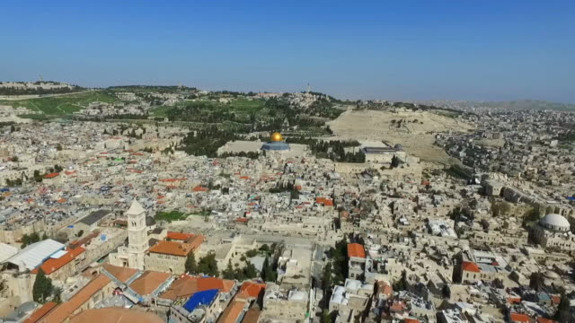 aerial shot of cityscape with famous landmark against blue sky, drone flying backward over buildings in city on sunny day - jerusalem, israel - jerusalem stock videos & royalty-free footage