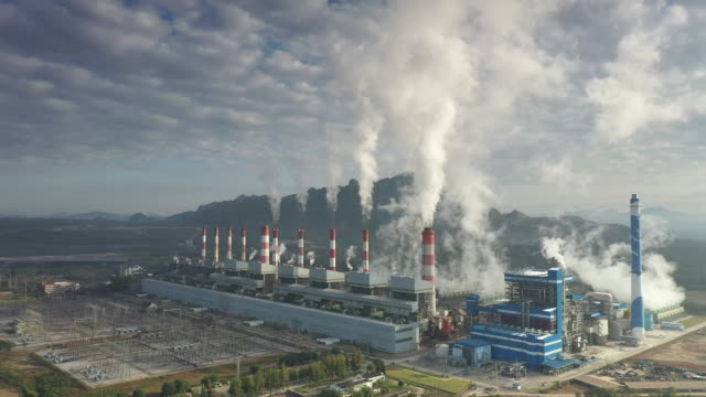 aerial shot of coal power plant in morning - coal stock videos & royalty-free footage