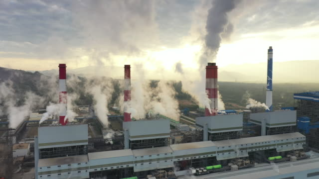 aerial shot of coal power plant in morning - coal fired power station stock videos & royalty-free footage