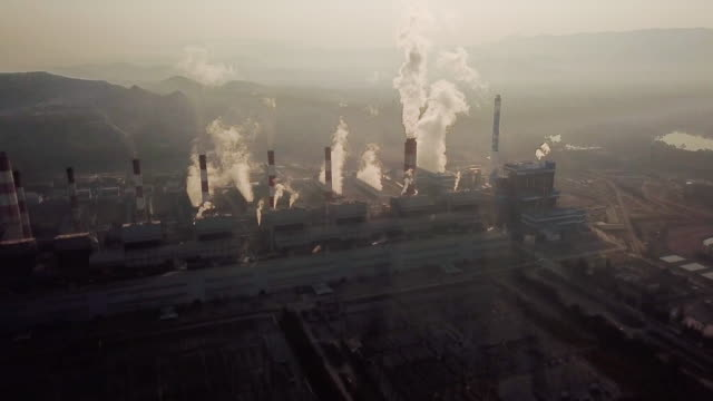 aerial shot of coal power plant , sunset time - coal stock videos & royalty-free footage