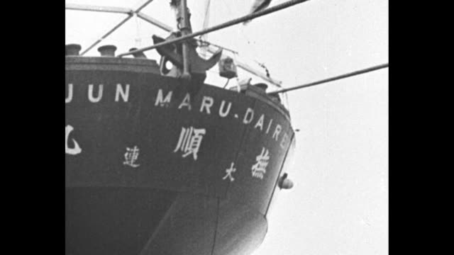 aerial shot of coast of manchukuo / two shots of japanese freighter entering harbor / japanese warship entering harbor / close view of guns on... - military ship stock videos & royalty-free footage