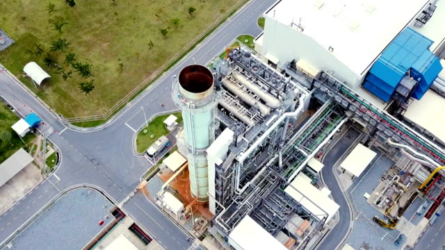aerial shot of combine cycle powerplant and cooling tower in asia - centrale elettrica video stock e b–roll