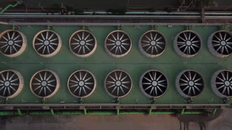 aerial shot of combine cycle powerplant and cooling tower - turbine stock videos & royalty-free footage