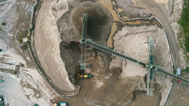 aerial shot of construction site - construction machinery stock videos & royalty-free footage
