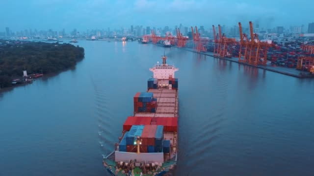 Aerial shot of container ship export and import at dockyard for logistic and transport in ocean of south east Asia