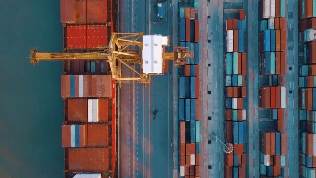 aerial shot of container ship export and import at dockyard for logistic in ocean of south east asia - container ship stock videos & royalty-free footage