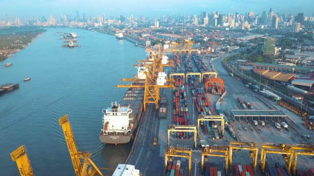 Aerial shot of container ship export and import at dockyard for logistic in ocean of south east Asia