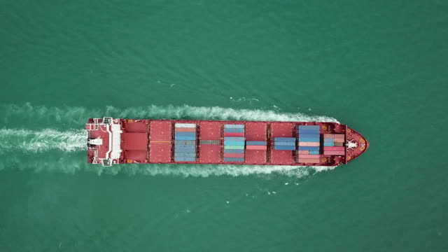 aerial shot of container ship in ocean, top view composition - physical activity stock videos & royalty-free footage