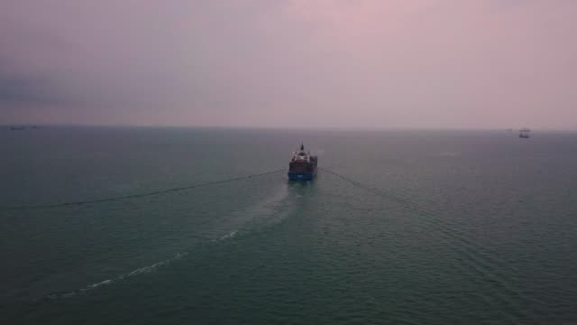 aerial shot of container ship in ocean - container stock videos & royalty-free footage