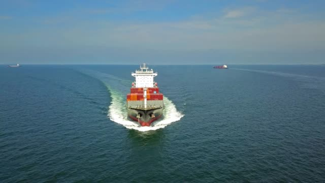aerial shot of container ship in ocean. - tanker stock videos & royalty-free footage