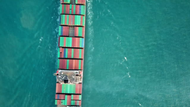 Aerial shot of container ship in ocean.