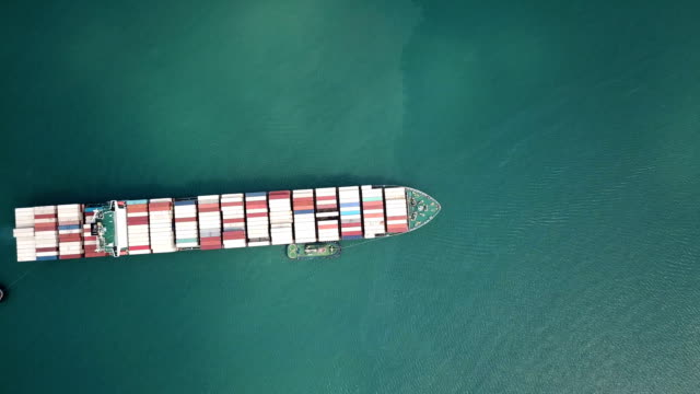 aerial shot of container ship in ocean. - container stock videos and b-roll footage