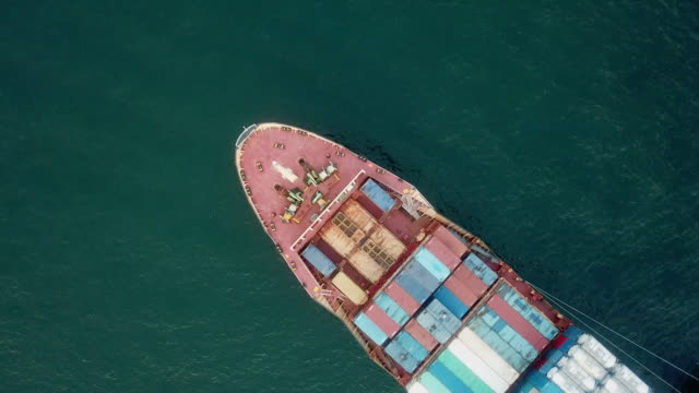 aerial shot of container ship - shipping stock videos & royalty-free footage