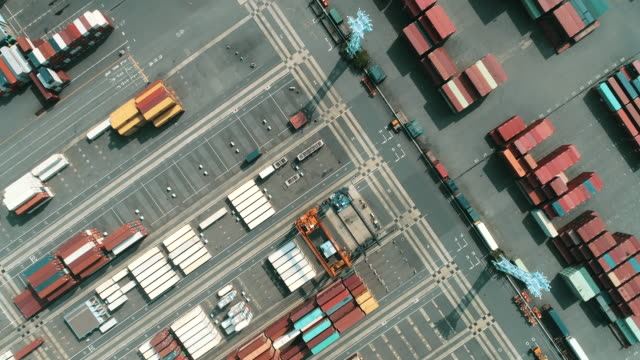 vídeos de stock, filmes e b-roll de aerial shot of containers in industrial harbor - business finance and industry