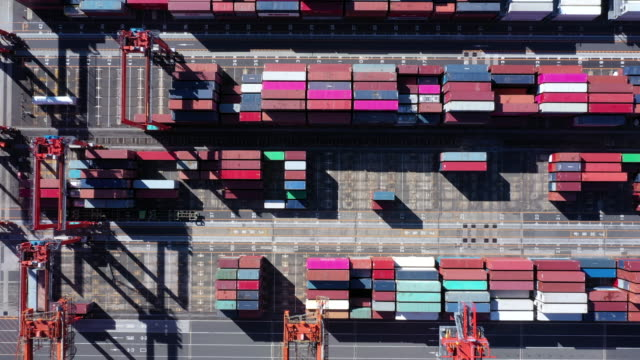 aerial shot of containers in industrial harbor - container stock videos & royalty-free footage