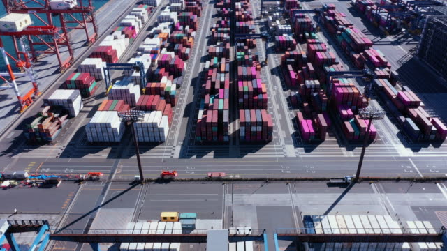 aerial shot of containers in industrial harbor - industrial building stock videos & royalty-free footage