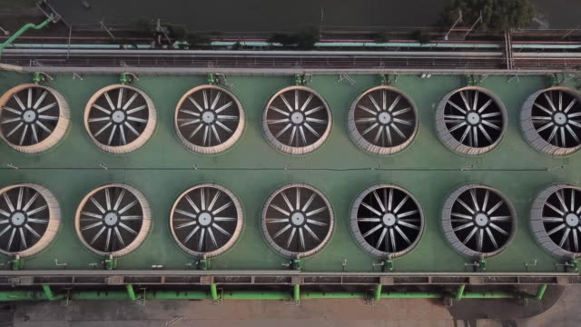 aerial shot of cooling tower and cooling fan of combine cycle power plan - cooling tower stock videos & royalty-free footage