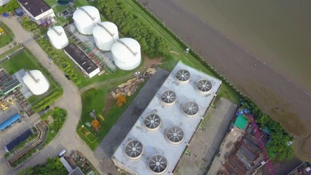 aerial shot of cooling tower of combined cycle power plant - cooling tower stock videos & royalty-free footage
