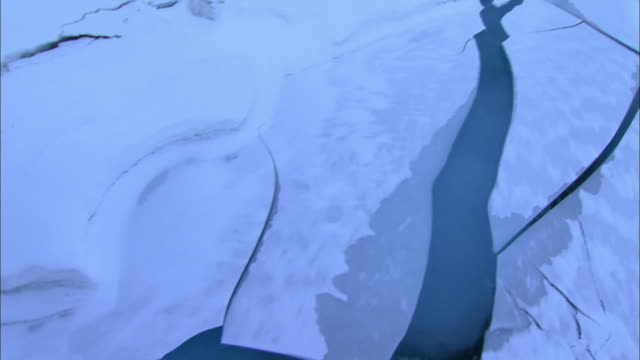 Aerial Shot of cracking Pack Ice at Antarctica
