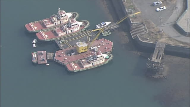 aerial shot of crane barge named daikongomaru in miike port fukuoka prefecture one of the sites of japan's industrial revolution in the meiji era... - ariake sea stock videos and b-roll footage