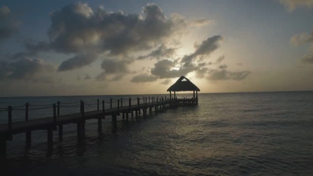 aerial shot of dock and ocean horizon - cozumel stock videos and b-roll footage