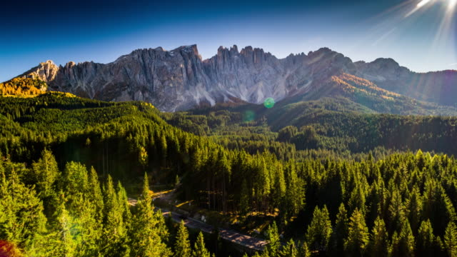 vídeos de stock e filmes b-roll de aerial shot of dolomite alps at latemar mountain in south tyrol, italy - horizontal