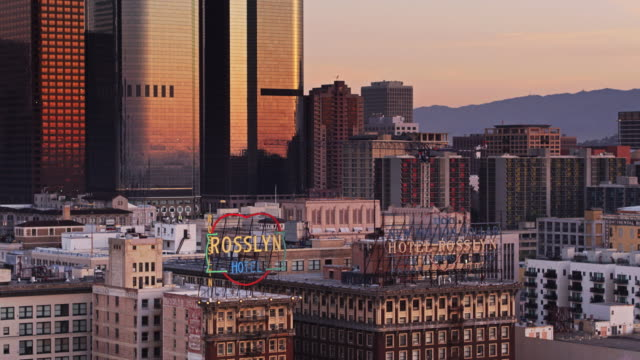 aerial shot of downtown los angeles at sunrise - western script stock videos & royalty-free footage